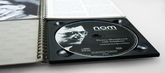 Блокнот на пружине с CD диском. Крепление диска в трей