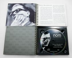 Блокнот на пружине с CD диском.